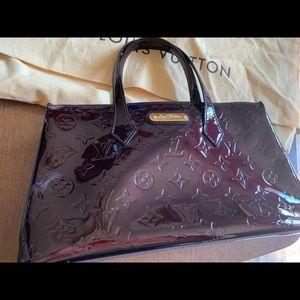 Patent leather Louis Vuitton handbag